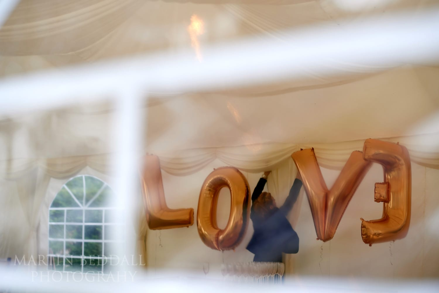 Hanging up the Love sign at Burley Manor wedding