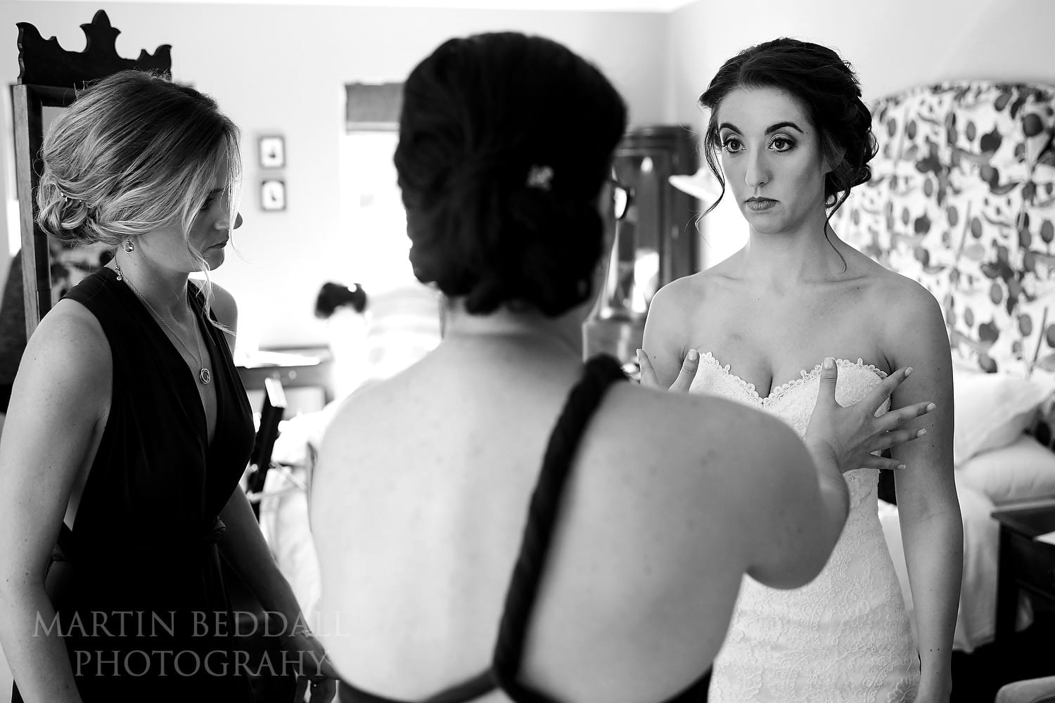 Helping the bride get dressed at Burley Manor wedding