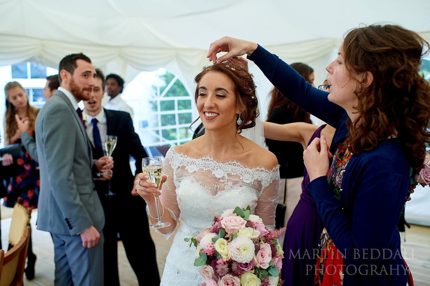 Picking confetti out of the bride's hair