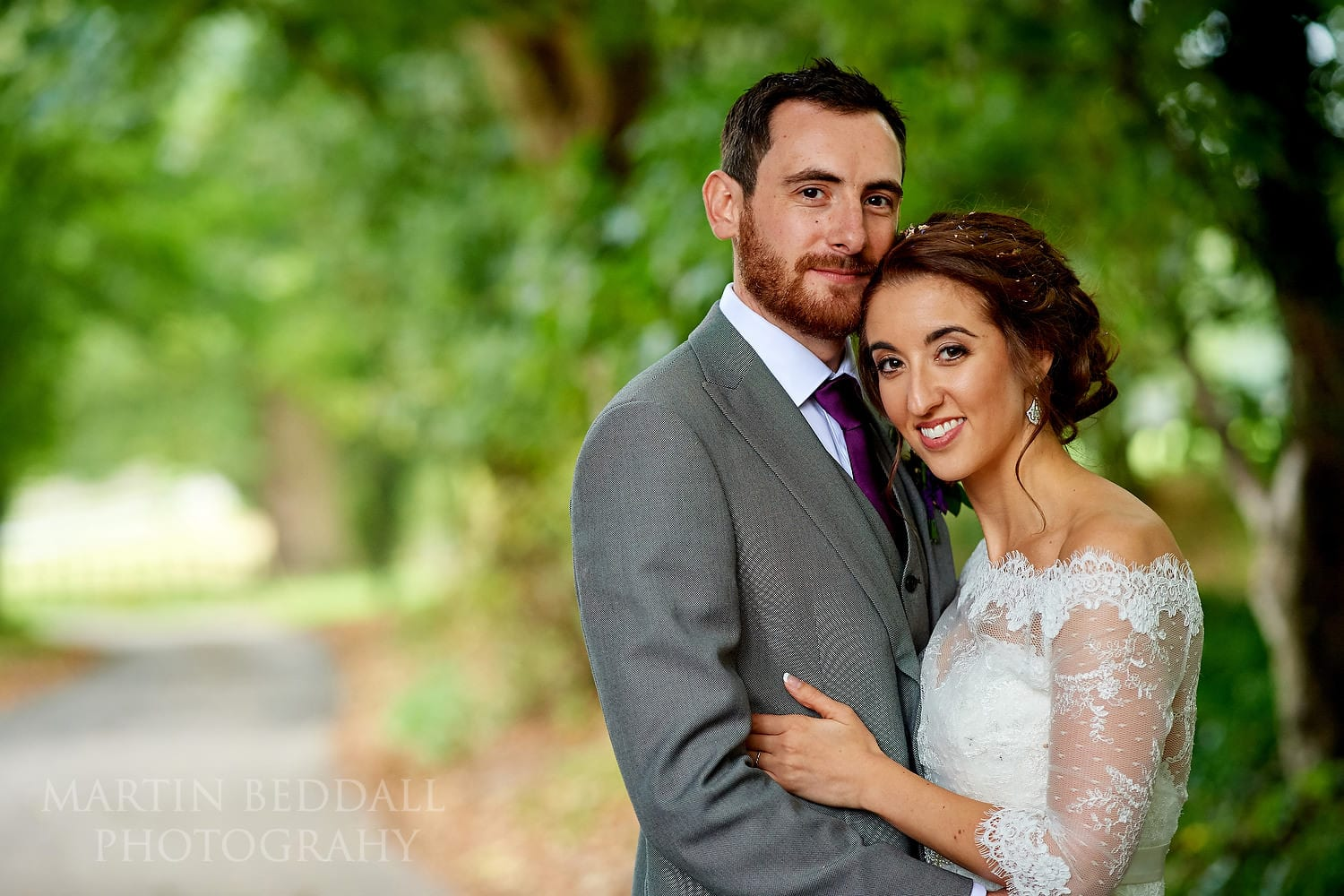 Quick couple portrait before the rain at Burley Manor wedding