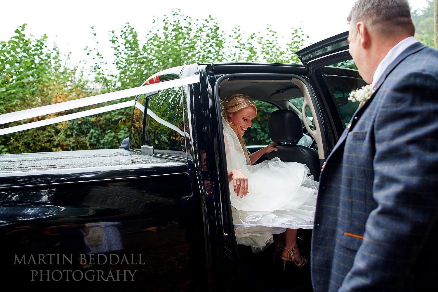 Bride arrives at Highclere church in a big pickup