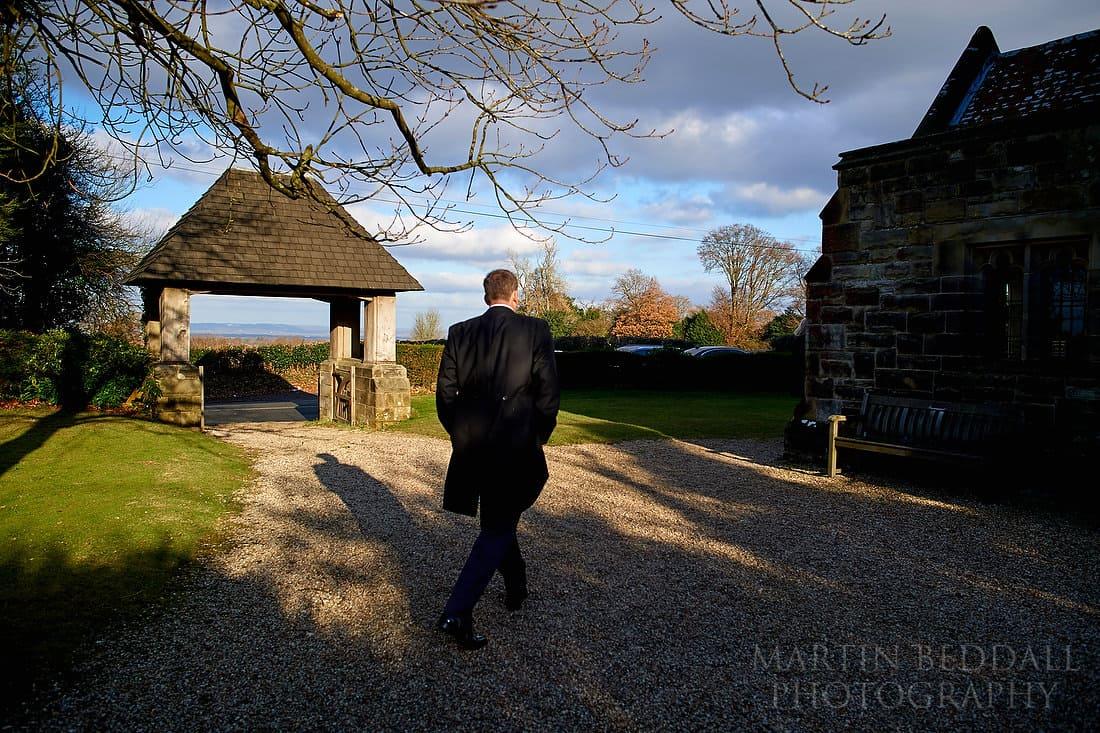 Groom walks to the church