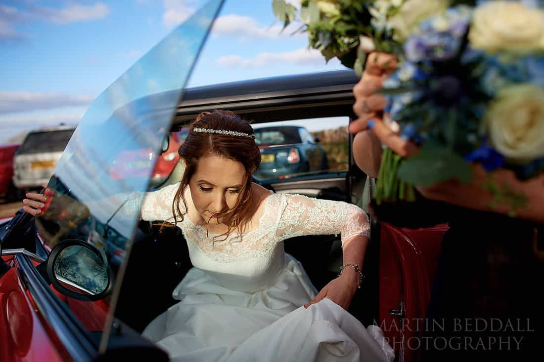 Bride gets out of the mini
