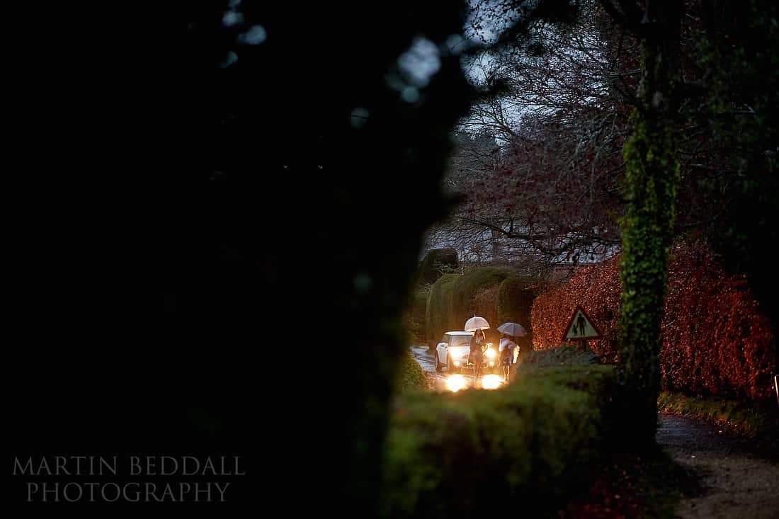 arrival of the wedding car in the rain