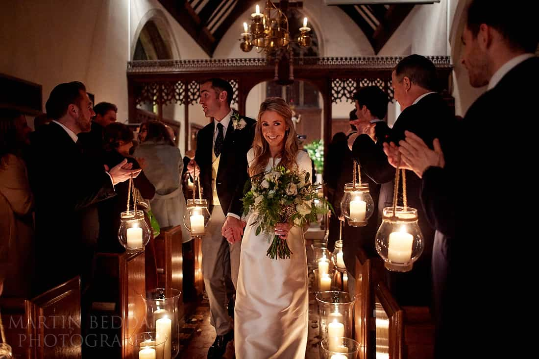down the aisle with lanterns