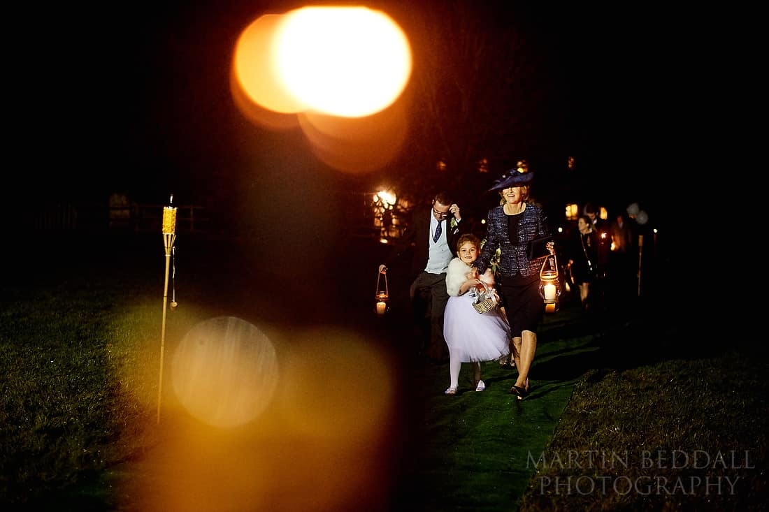 lantern carrying wedding guests