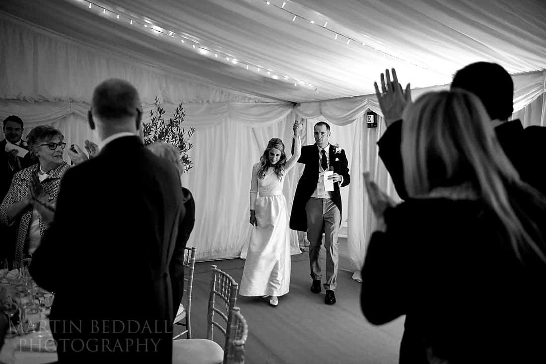 bride and groom entrance to the meal