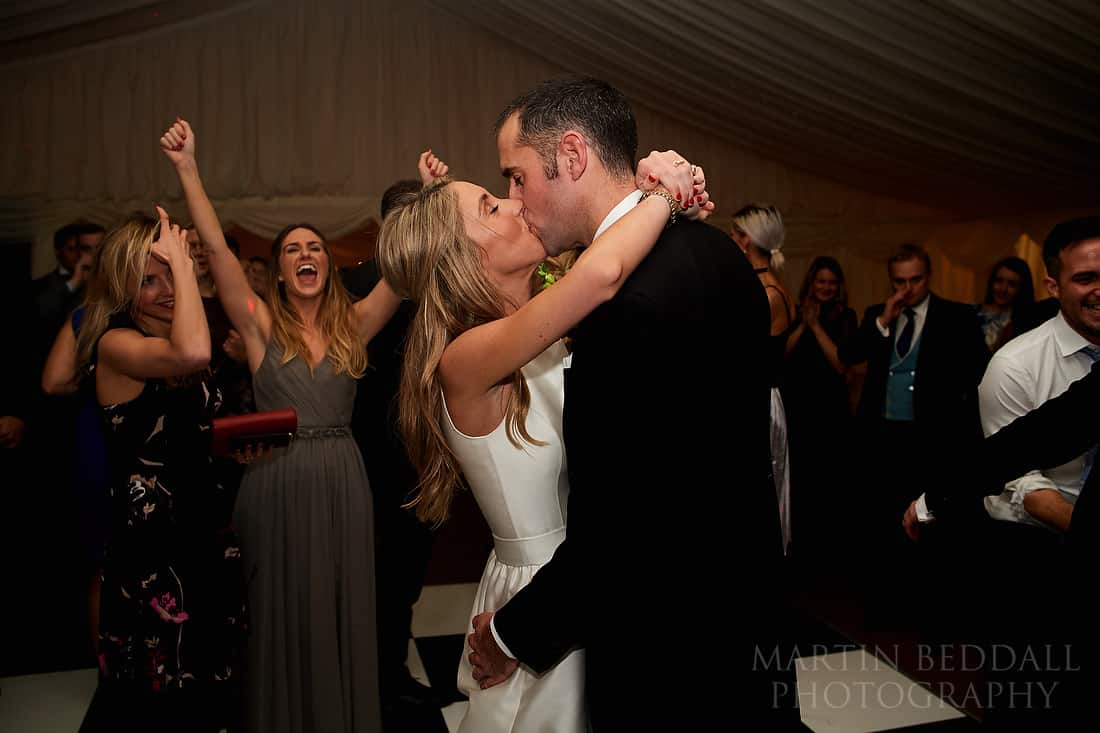bride and groom kiss on the dancefloor