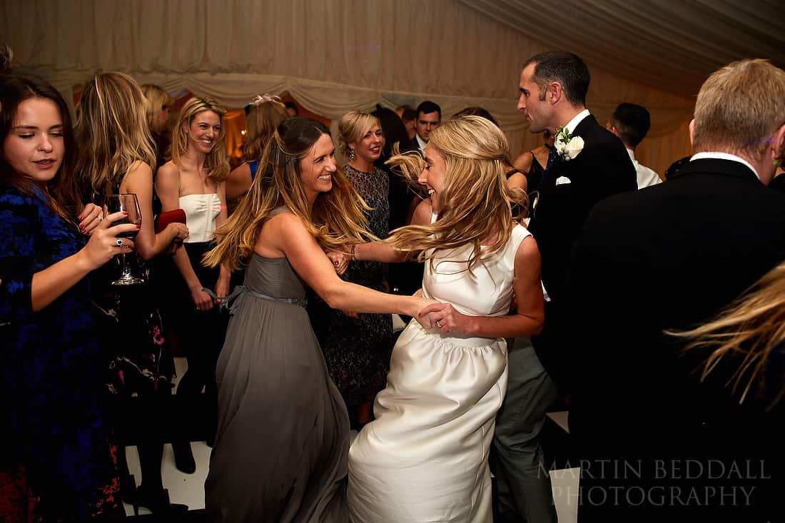 bride dancing with her best friend
