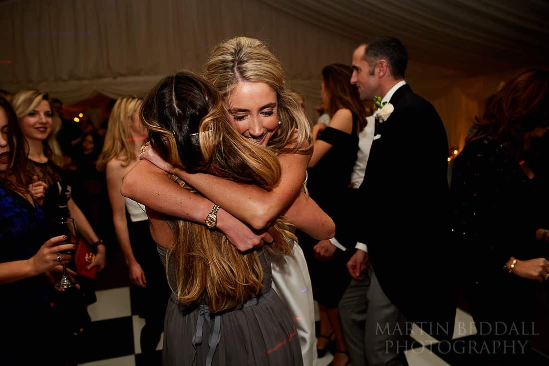 bride hugs her best friend