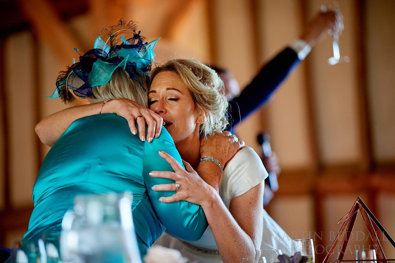Bride embrace at Southend Barns