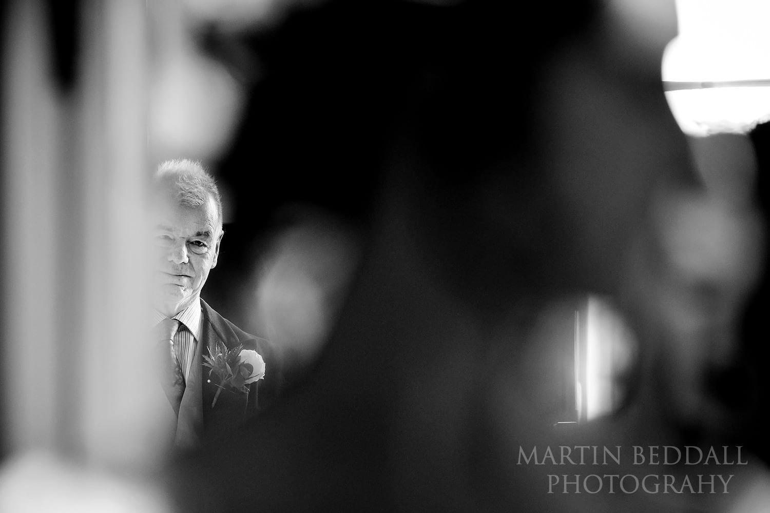 Father of the bride watches his daughter