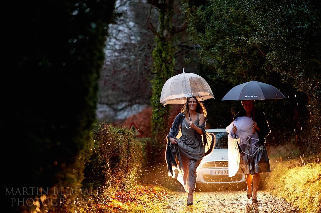 Wedding car arrives in the rain
