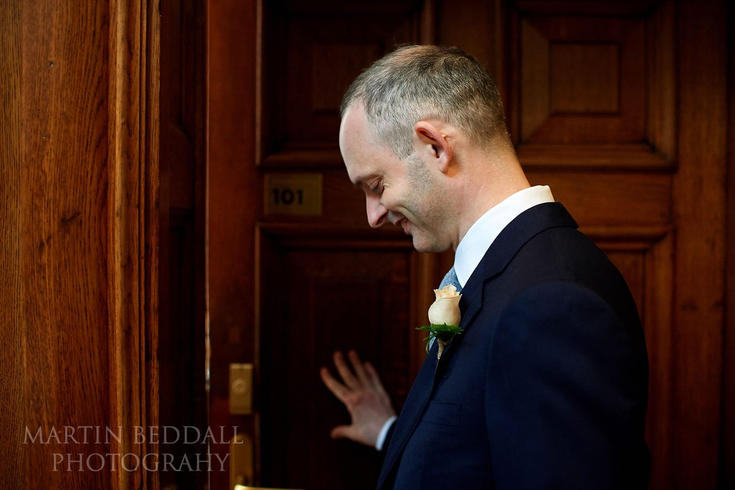 Groom waits for the 'first look' at the Town Hall Hotel