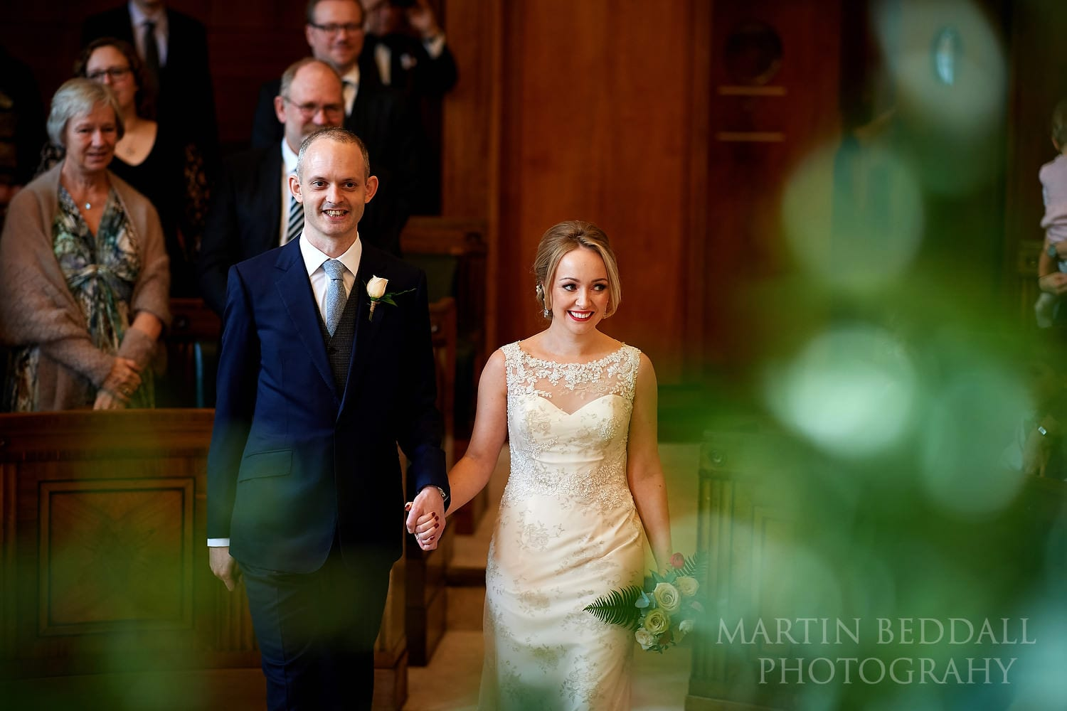 Bride and groom enter the council chamber at the Town Hall Hotel