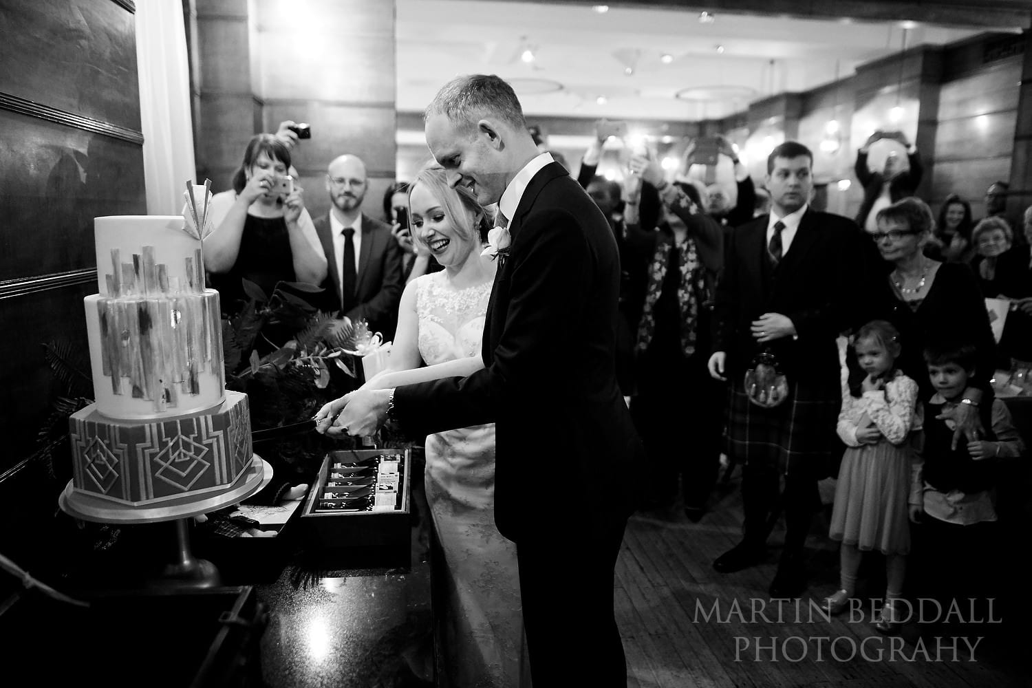 Cutting the wedding cake at Town Hall Hotel
