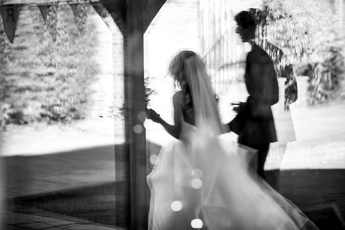 Reflection of the bride and groom