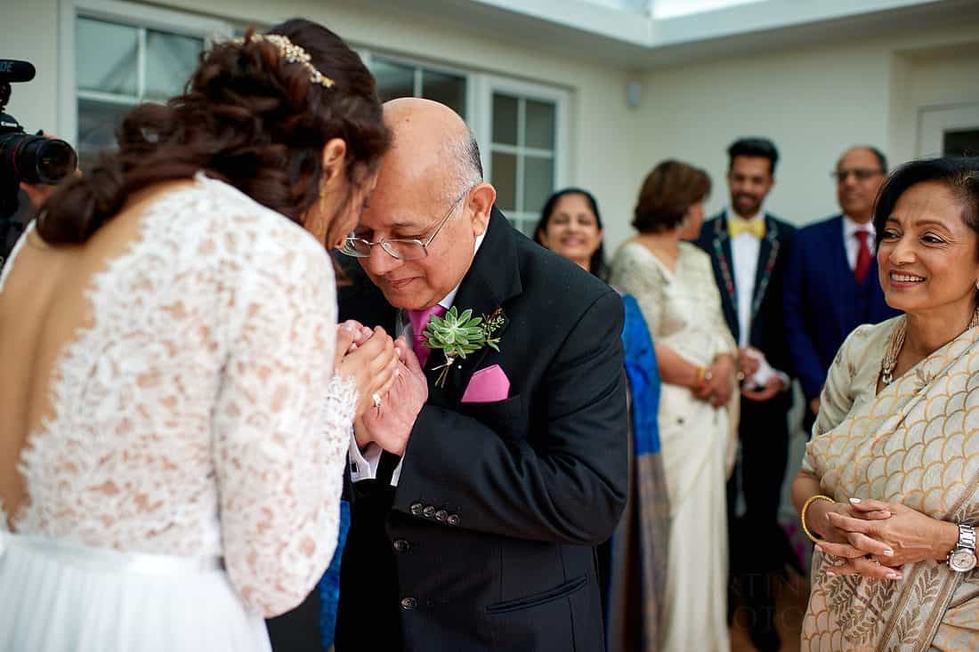 Bride blessed by her father and mother