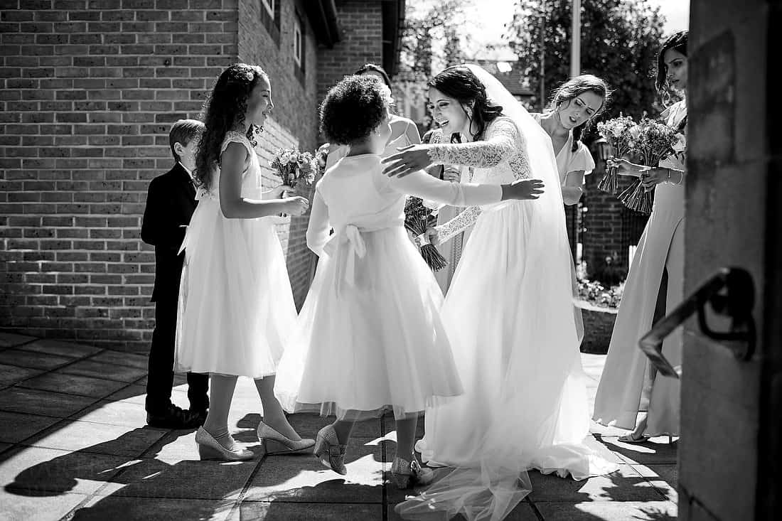 Bride greets the flower girls