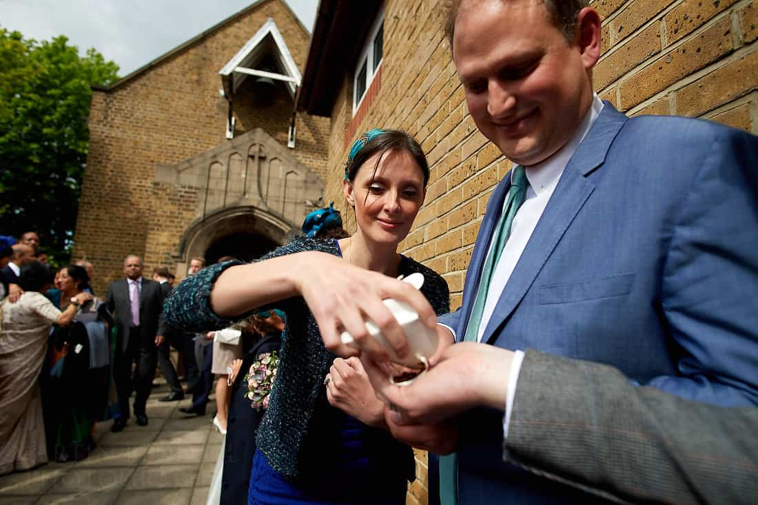 Handing out the wedding confetti