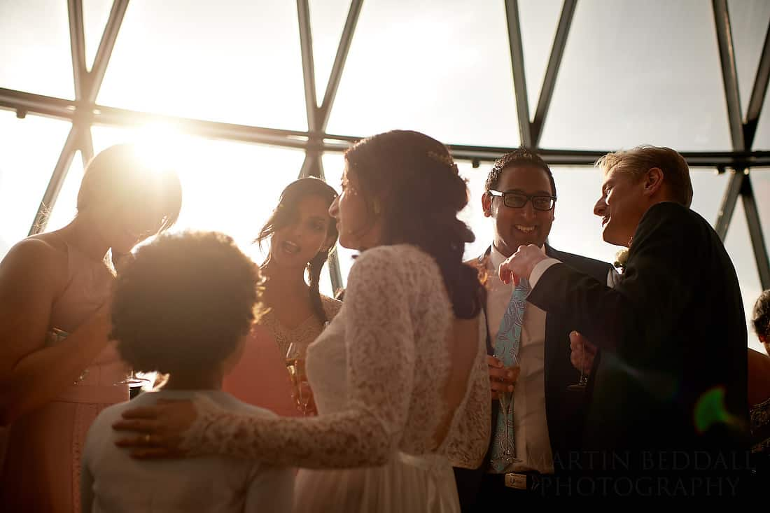 sun shines onto gherkin wedding reception
