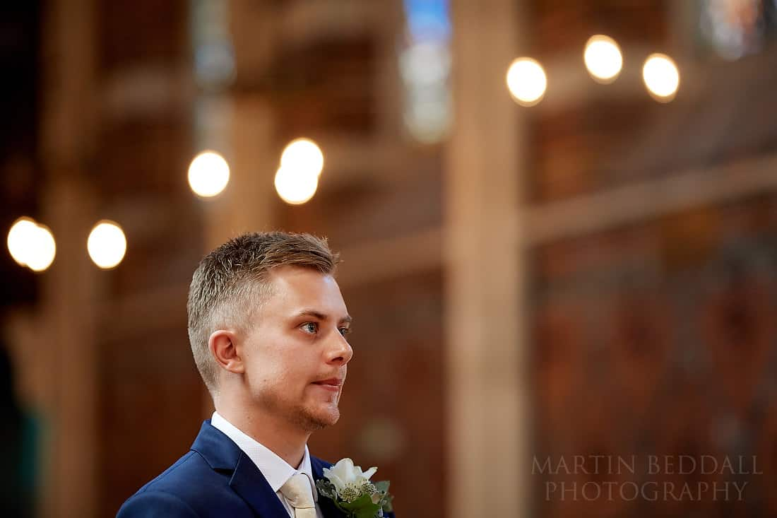 Groom waiting in the chapel