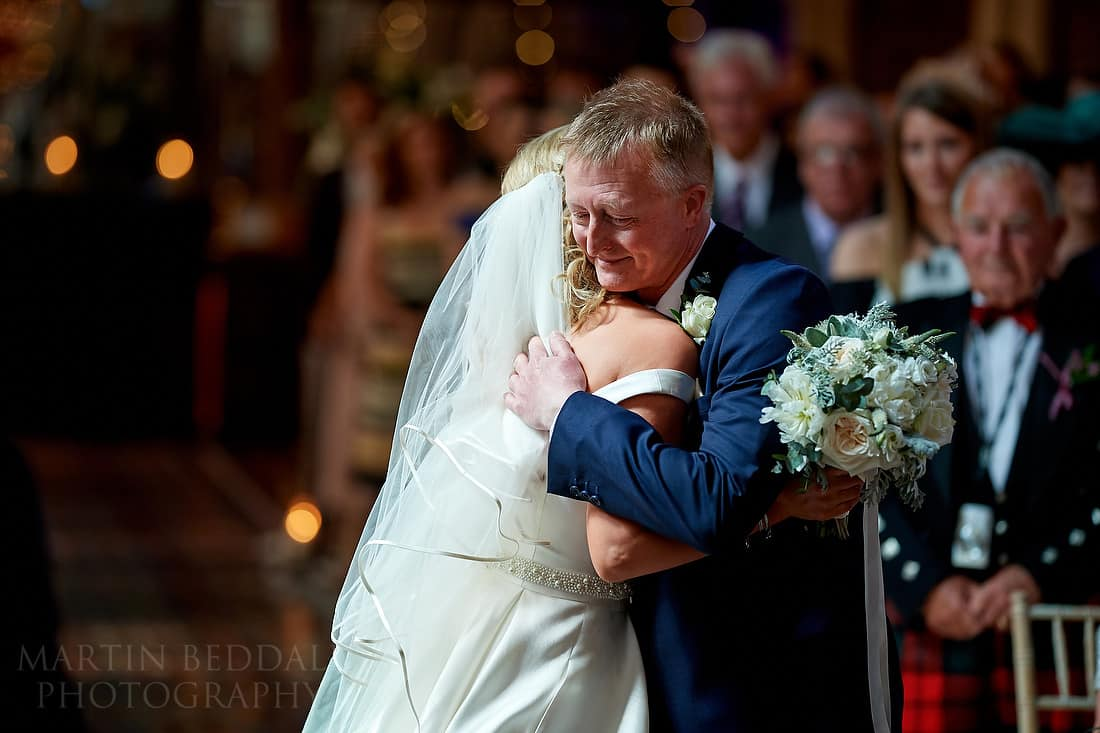 Bride and her father hug