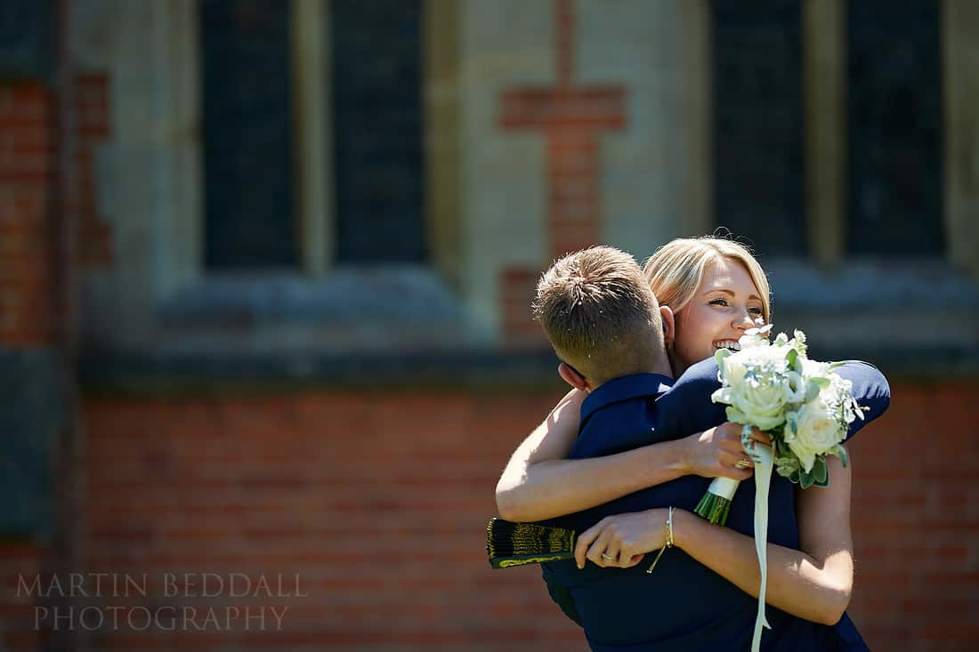 Groom gets a hug from his sister in law