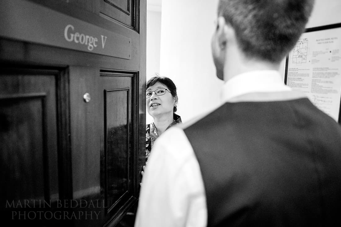 Bride's mother lets the groom in