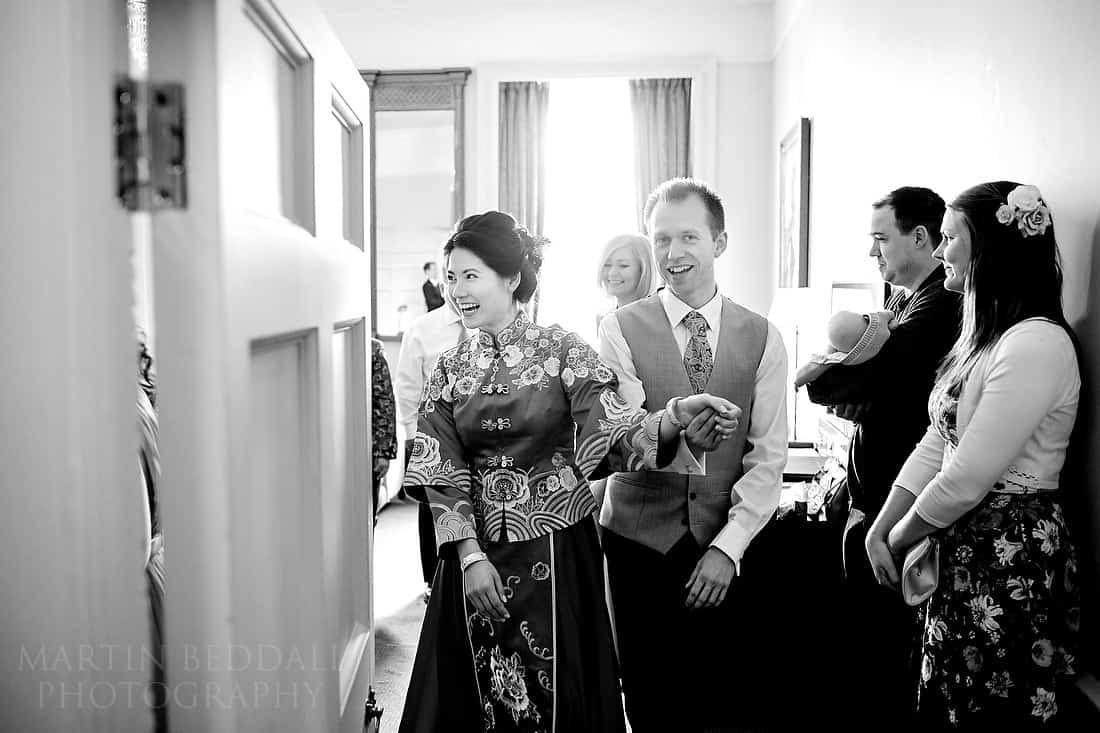 Groom escorts the bride
