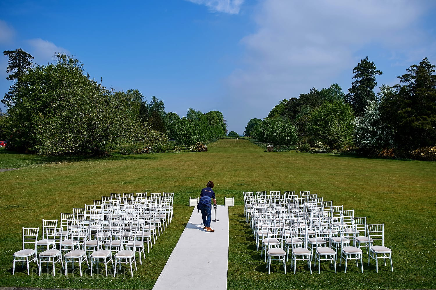 Staff getting the outdoor wedding ready at Buxted Park