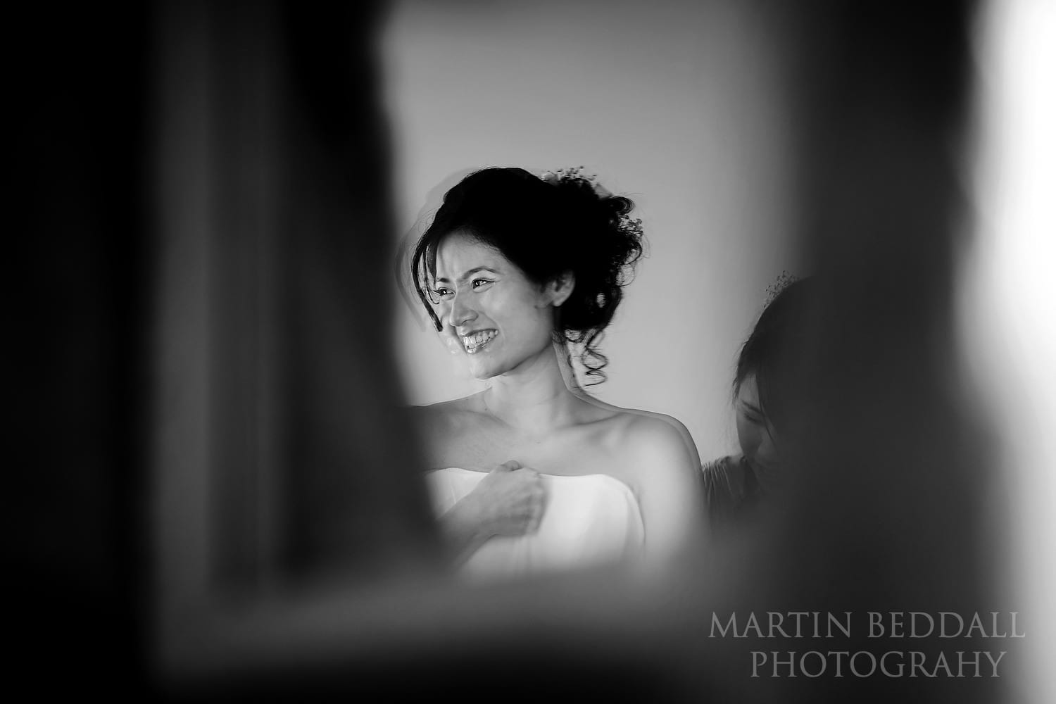 Buxted Park mirror reflects the bride smiling