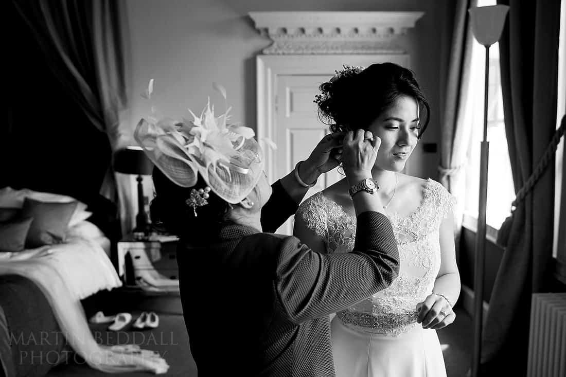 Bride's mother fixes her earrings