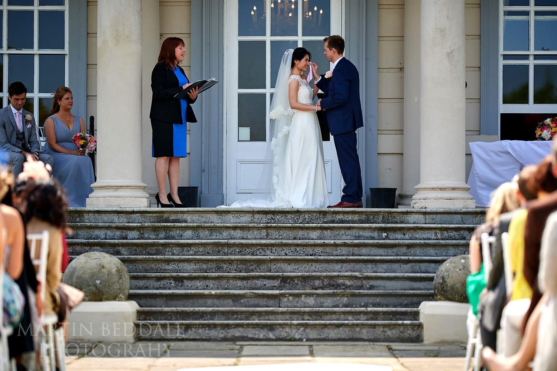 Groom clears the bride's tears