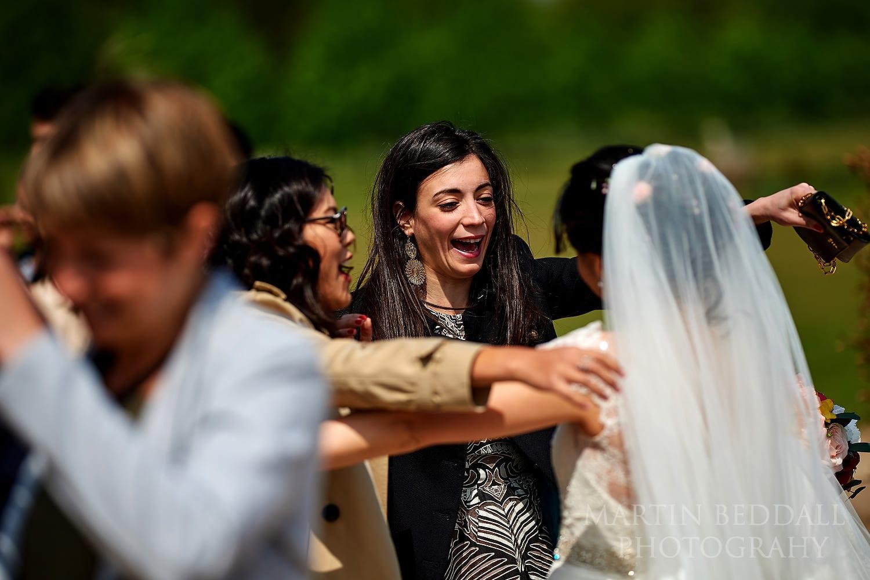 Friends hug the bride