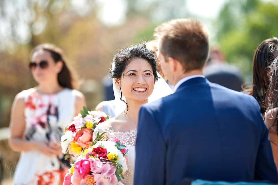 Bride smiles at the groom