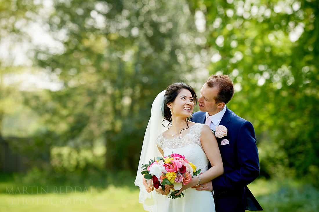 Bride and groom portrait at Buxted Park hotel in Sussex