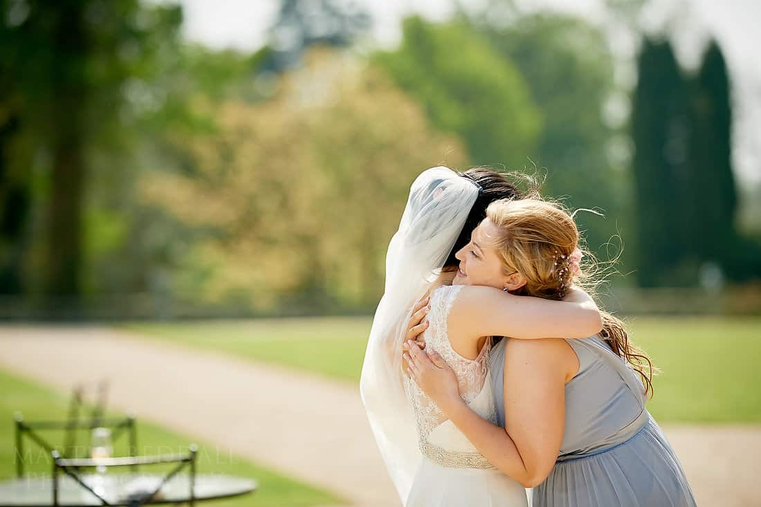 Bride hugs her friend