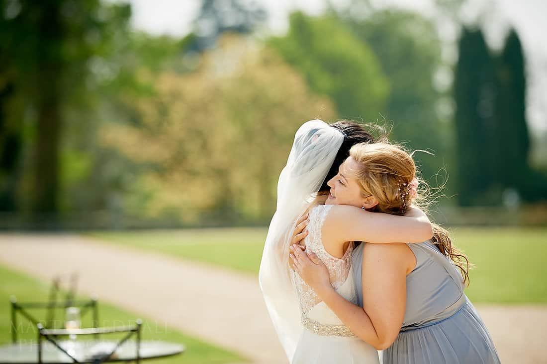 Bride hugs her friend