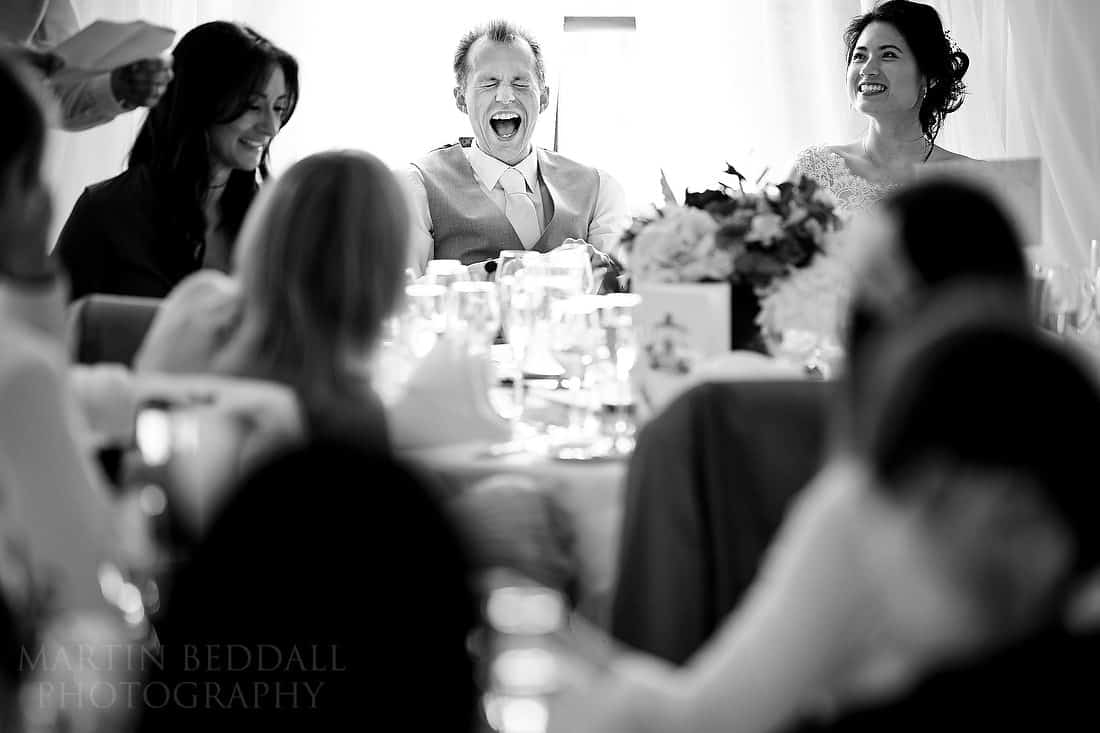 Groom roars with laughter at best man's speech