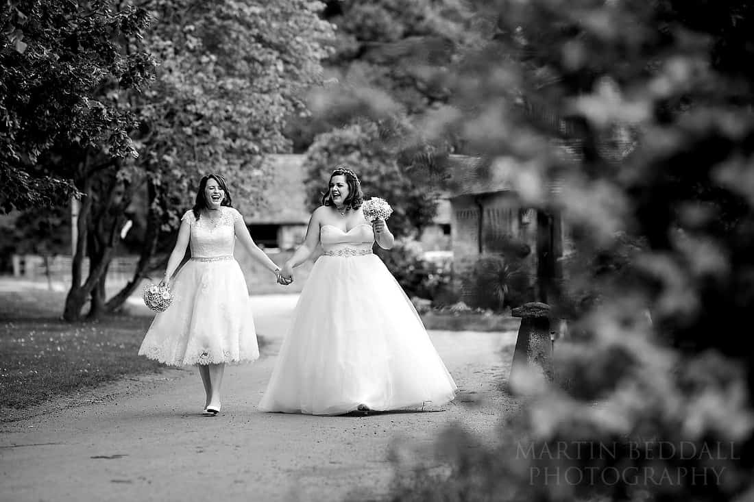 Two brides walk hand in hand