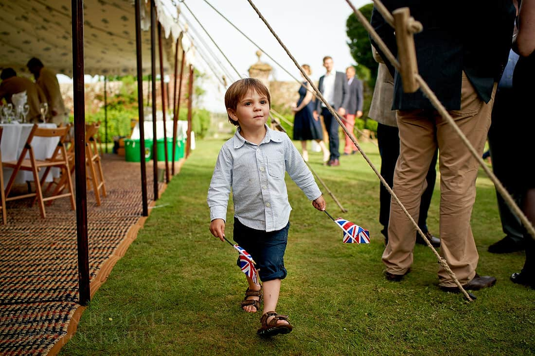Boy with two British flags