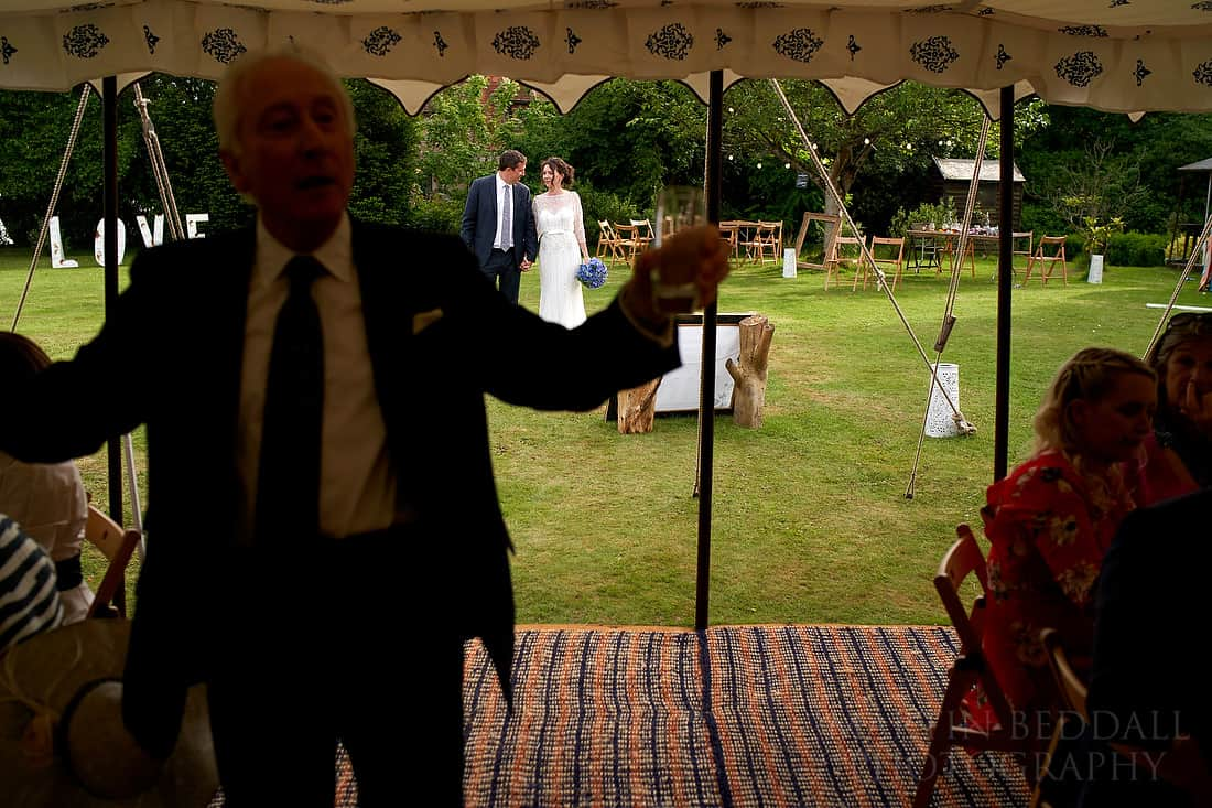 Grandfather announces the bride and groom in for dinner