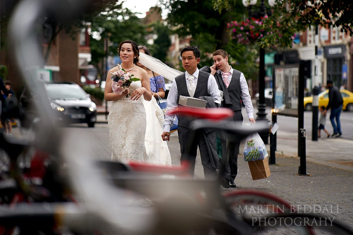 Bride asnd groom arrive for their small London wedding at Islington Town Hall