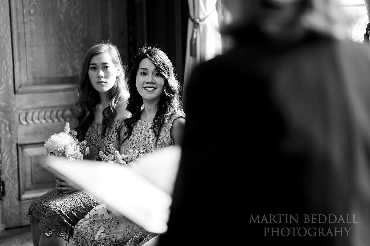 Bridesmaids listening to the registrar