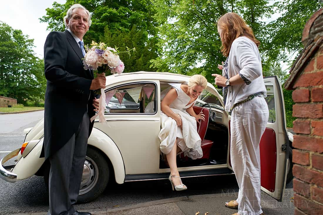 bride steps out of car