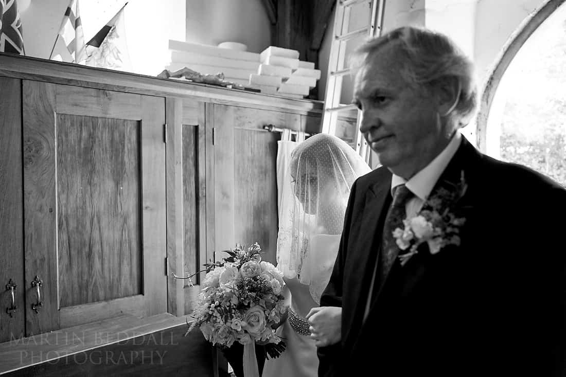 Bride walks into church with her father