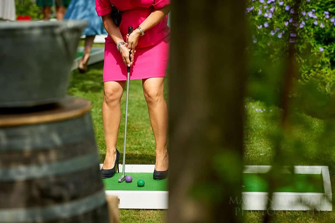 mini golf at wedding in heels