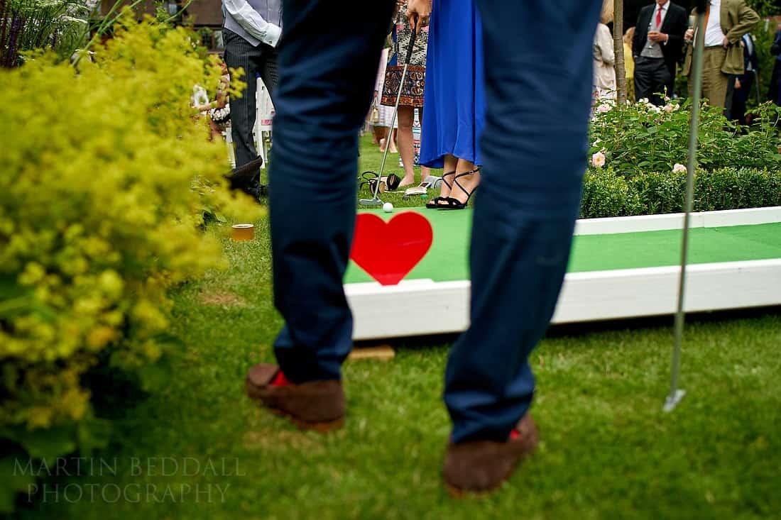 mini golf at wedding reception