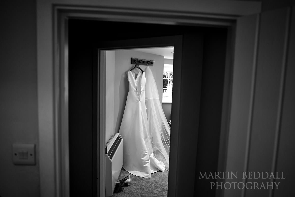 Wedding dress hanging up at Farnham Castle